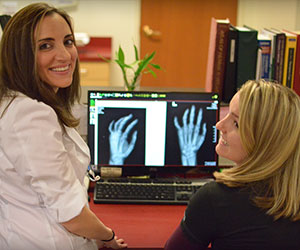 the miniER staff looking at a hand x-ray