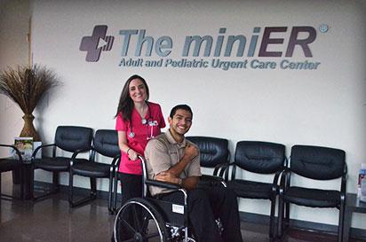 a nurse helping a man in a wheel chair at the miniER